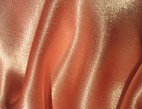 Draped peachy satin background Stock Photography