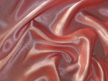 Draped pink (peachy) satin background stock images