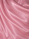 Draped pink silk background Stock Photos