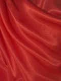 Draped red silk background Stock Photos