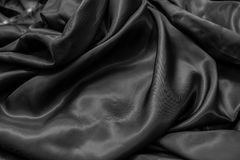 Draped silver cloth. Abstract background Royalty Free Stock Image