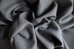 Draped unprinted dark grey viscose fabric. Draped simple unprinted dark grey viscose fabric Royalty Free Stock Photo