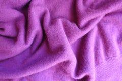 Draped thin deep pink knitted fabric. Draped thin simple deep pink knitted fabric royalty free stock photos