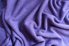 Draped violet thin simple woollen jersey fabric. Draped violet thin simple woolen jersey fabric Royalty Free Stock Photos