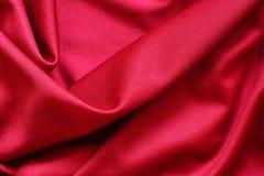 Drapeje do pano vermelho imagem de stock