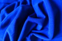 Draperade elkraftblått slätar torkduken Fotografering för Bildbyråer