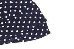 Draperat blått silke med prickar som en bakgrund royaltyfri bild