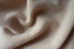 Draperat enkelt beige woolen stuckit tyg royaltyfri foto