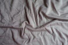 Draperat grått viskost tyg från över royaltyfri fotografi