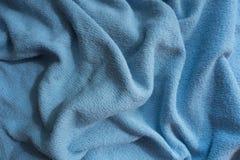 Draperat tyg för himmelblått utan tryck royaltyfri foto
