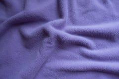 Draperat violett ullbeklädnadtyg från över royaltyfria bilder