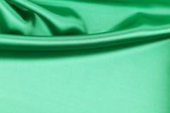 Draperie en soie verte Photo libre de droits