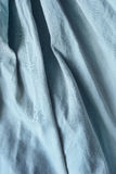 Drapery. Draped blue linen as a background Royalty Free Stock Photo