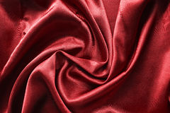 Drapery. Draped red satin closeup as a background Stock Photography