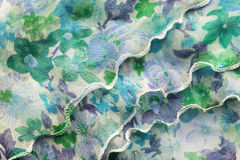 Drapery. Frills of painted green silk as a background Royalty Free Stock Images