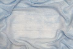 It is  drapery of light blue fabric. Royalty Free Stock Photography