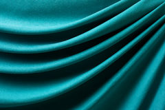 Drapery of turquoise fabric Stock Photo