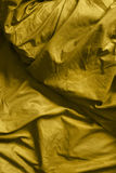 Drapery. Yellow crumpled blanket as a background Stock Photo