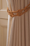 Drapes. Close up detail of window drapes with ornate tie back Stock Photo