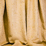 Drapes of golden damask material Royalty Free Stock Photography