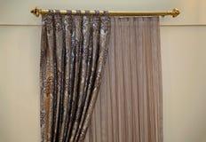 Drapes. Vintage decorative drapes details on gold rod Royalty Free Stock Images