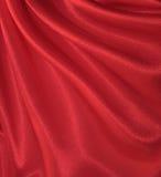 Drapierter roter silk Hintergrund Lizenzfreies Stockfoto