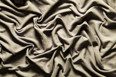 Draping fabric cloth shiny gray vintage. Wavy background. Stock Image