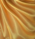 Drapujący złoty jedwabniczy tło Obrazy Royalty Free