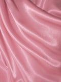 Drapujący różowy jedwabniczy tło Zdjęcia Stock