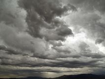 Drastic skies. Stormy clouds by a mountain range Royalty Free Stock Photos