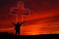 Schattenbild eines Mannes vor einem Symbol des Glaubens Stockbilder