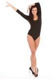 Drastische Tanzenhaltung des reizvollen langen mit Beinen versehenen Mädchens Lizenzfreie Stockbilder