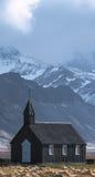 Drastischer Himmel über Budakirkja-Kirche in Budir, Island Stockfotografie