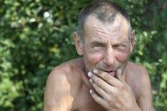 Drastisches Porträt des älteren Mannes Stockfotos