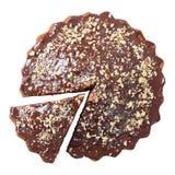 Draufsicht der glasig-glänzenden und besprühten Torte mit geschnittenem Stück Lizenzfreie Stockfotografie