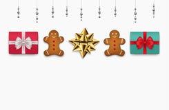 Draufsicht der Weihnachtsgeschenke über einen weißen Hintergrund Lizenzfreie Stockfotos