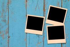 Draufsicht des leeren sofortigen polaroidfotoalbums Stockbild