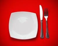 Draufsicht des Messers, der Platte und der Gabel Lizenzfreies Stockfoto