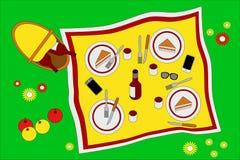 Draufsicht des Picknicks auf einer Tischdecke Lizenzfreie Stockfotografie