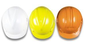 Draufsicht des Schutzhelms weiß, gelb, orange, Sicherheit constructio Lizenzfreies Stockfoto