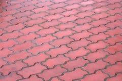 Draufsicht des Straßenbetoniermaschinengehwegs des roten Backsteins Lizenzfreies Stockfoto
