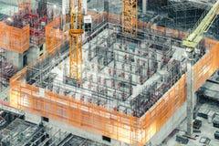 Draufsicht eines im Bau Gebäudes Tiefbau, industrielles Entwicklungsprojekt, Turmkellerinfrastruktur lizenzfreie stockfotos