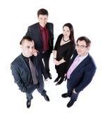 Draufsicht von vier Geschäftsleuten Stockfotografie