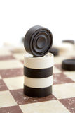 Draughs or checkers on old paper board Stock Photo
