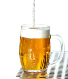 Draught beer. To the glass on saucer on white background Royalty Free Stock Photography