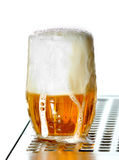 Draught beer. To the glass on saucer on white background Royalty Free Stock Photo