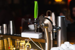 Draught Beer in a Bar. Bar equipment stock photography
