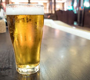 Draught beer with foam in restaurant Royalty Free Stock Photography