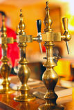 Draught beer front. Antic in a pub Royalty Free Stock Image