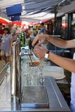 Draught Beer Tap. Pouring Draught Beer at Outdoor Market Royalty Free Stock Photo